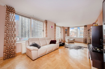 Upper East Side: Sprawling Corner 3 Bedroom 3 Bathroom Condo with Private Terrace in White Glove Building